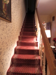 Narrow den staircase.
