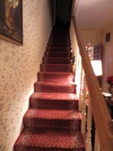 Narrow den staircase.