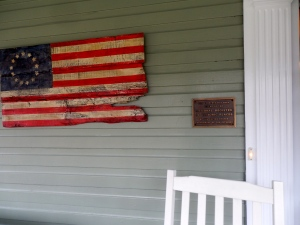 Front porch had historic register designation and wooden flag.