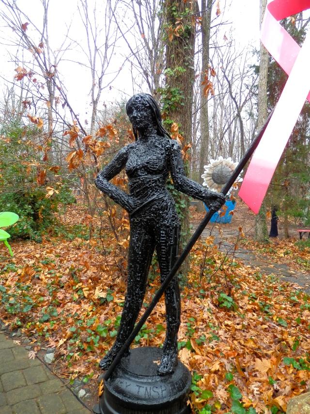 Woman waving pink ribbon.